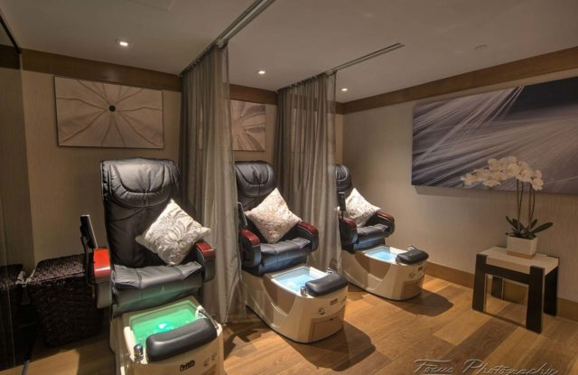 inside artne spa's salon room of three pedicure chairs